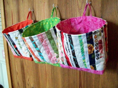 fabric buckets hanging on the wall