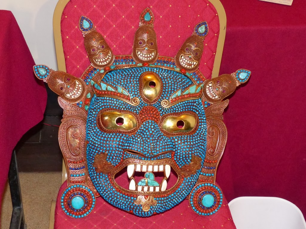 Traditional metal mask decorated with corals and turquoise, Nepal