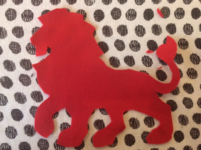 Lion cutout of red fabric