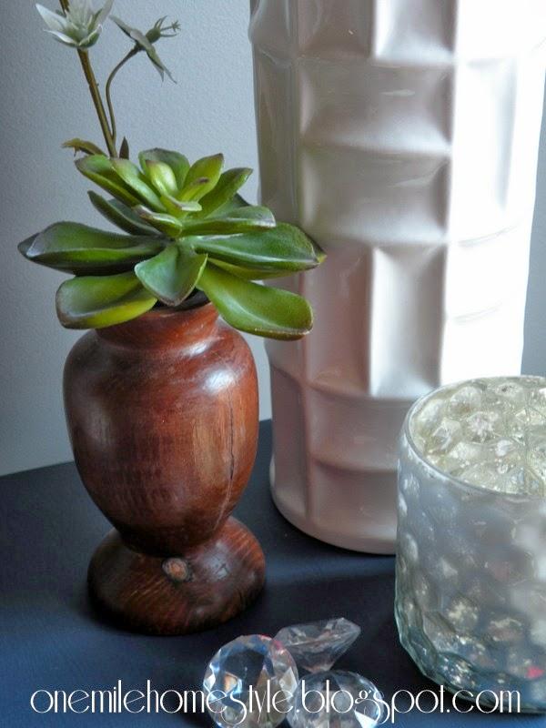 Faux succulent in wooden vase