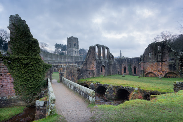 North Yorkshire Cistercian ruins of Fountains Abbey in the evening gloom