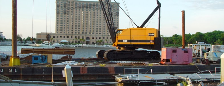 american 999c crawler working on barge