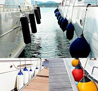Tekne yanlarında asılı olan çeşitli renk ve şekillerdeki usturmaçalar