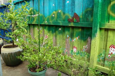 green gourmet giraffe a backyard mural forest fairies