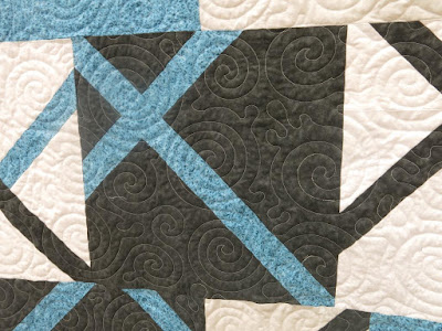 Close-up of Chassés-croisés quilt made by Francine Béliveau
