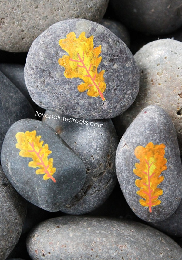 Painted rocks with oak leaves for fall - how to paint leaves onto rocks with Posca pens