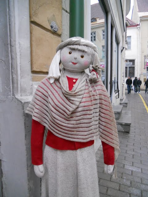 Plush model showcasing a shawl in Tallinn, Estonia