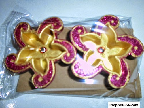 A pair of handmade designer Clay Diyas for Diwali