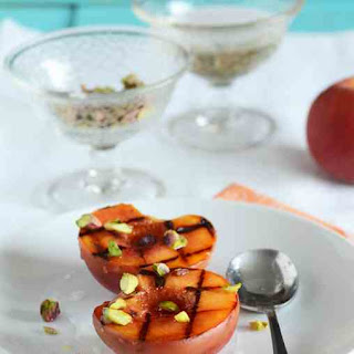 http://www.anediblemosaic.com/grilled-peaches-with-orange-blossom-syrup-pistachios/