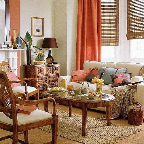 Neutral Color Tropical Living Room With Orange Curtains