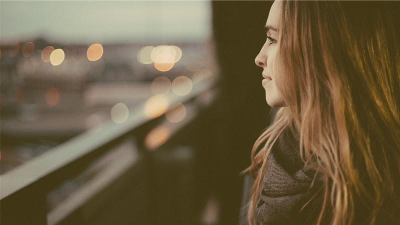 Beautiful lady watching the city lights HD