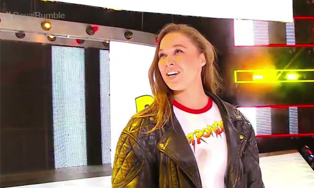 Ronda Rousey royal rumble appearance wearing Rowdy Piper leather jacket.  StrengthFighter.com