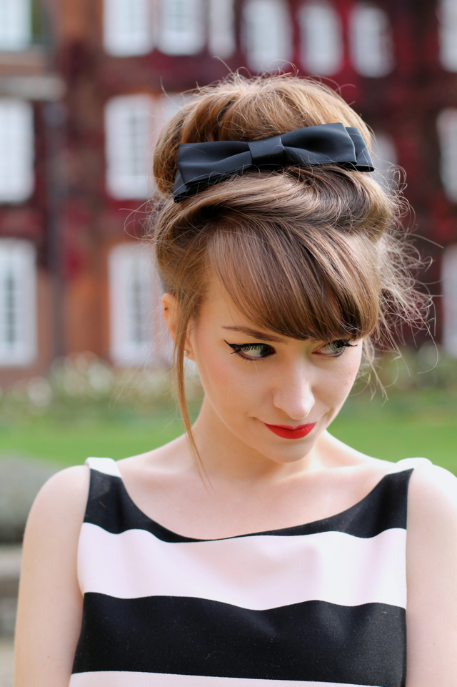 60s inspired big hair bun with satin bow