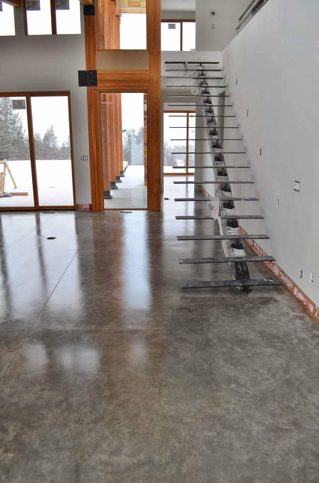 Natural concrete floors look amazing in this brand new contemporary home in kelowna bc