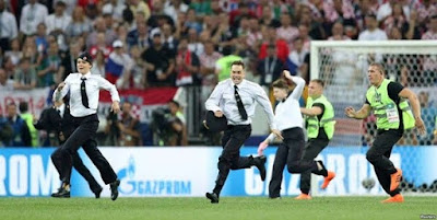 Members of Pussy Riot face punishment after pitch invasion interrupting 2018 World Cup final dressed as the police.