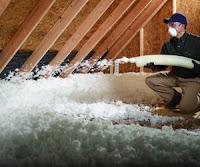 Blown-in fiberglass insulation in attic