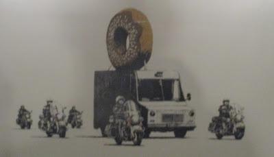 http://www.stencilrevolution.com/photopost/2012/09/Donut-Police-by-Banksy.jpg