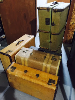Old suitcases waiting to be on display at Offbeat Avenue Boutique!