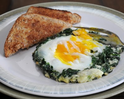 Easy Spinach Nests, an egg cooked in a 'nest' of fresh spinach, onion and a touch of cream.