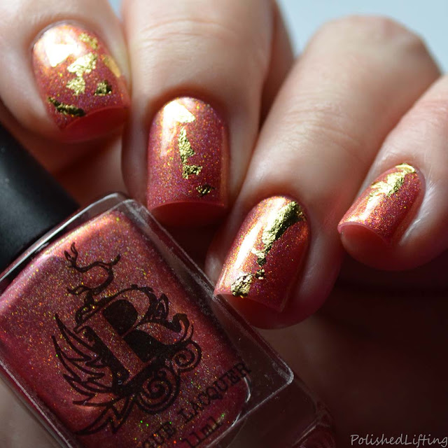 gold foil nail art over red holo polish