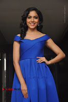 Actress Ritu Varma Pos in Blue Short Dress at Keshava Telugu Movie Audio Launch .COM 0081.jpg