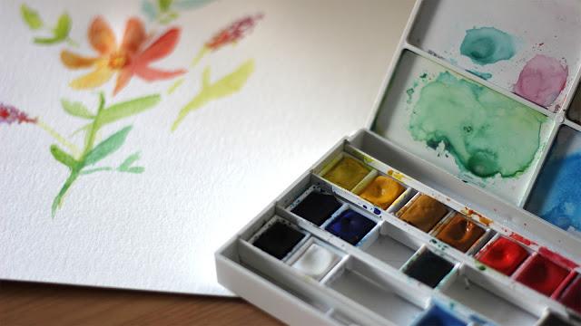 palette d'aquarelle et dessin