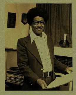 Conrad O. Johnson Sr. holding a Kashmere Stage Band record.