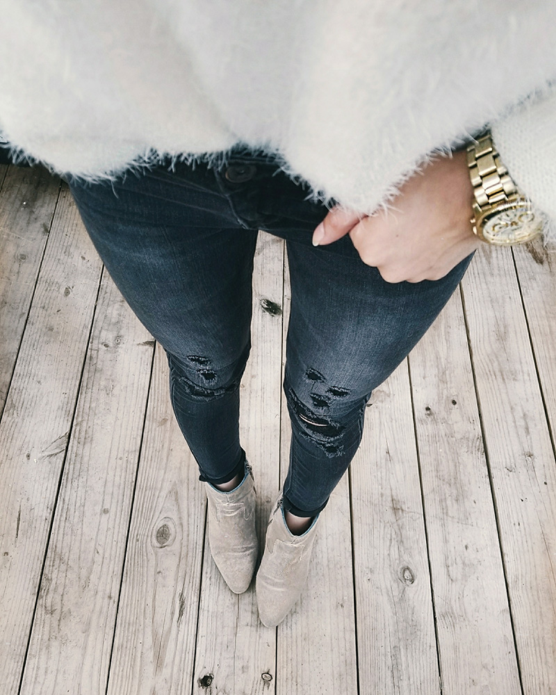 black ripped jeans taupe booties outfit