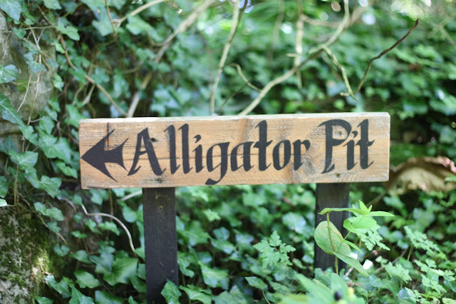 alligator pit sign at dewstow gardens and grottoes caerwent wales