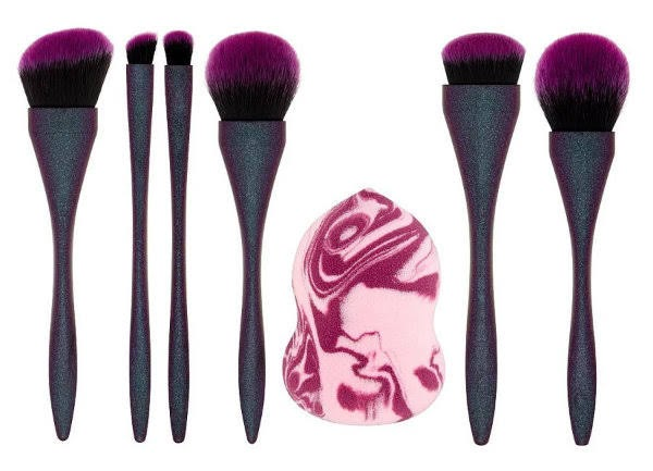 stock photos of row of purple makeup brushes and marbled blending sponge on white background