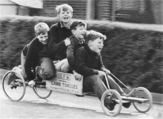 children-having-fun-on-home-made-trolley-cart