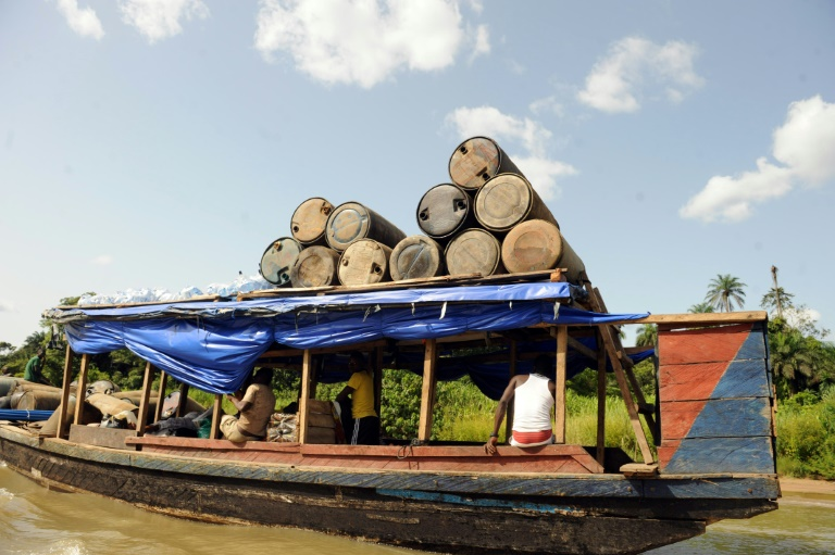 Products from illegal oil refineries run by oil thieves are ferried to the market in Bayelsa State, Niger Delta