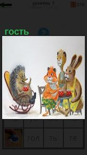 За столом звери и на кресле качалке сидит гость ежик, что то рассказывает