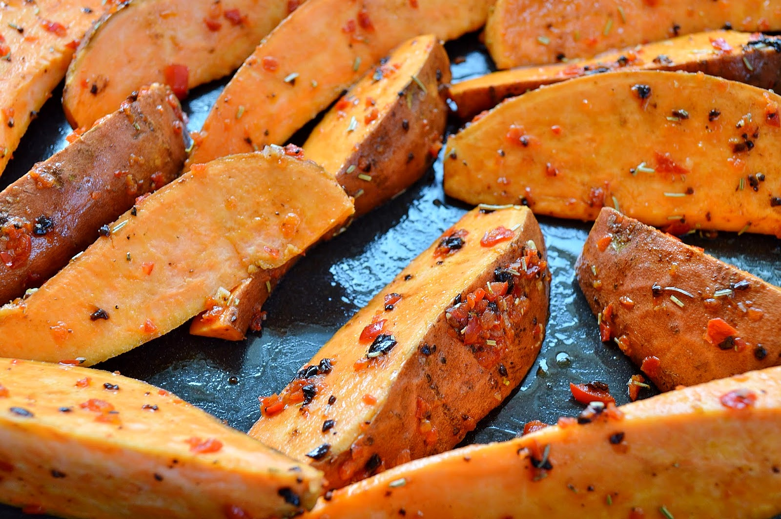 Coast the sweet potatoes with the black garlic, herbs and chilli pepper dressing