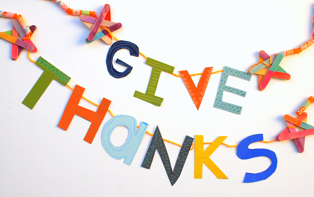 Give Thanks Thanksgiving Banner made from straws, washi tape, paint chips, popsicle sticks, yarn, and colored pencil