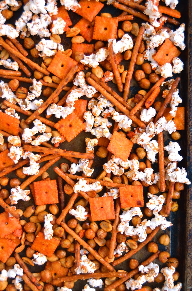 Buffalo Chickpea Snack Mix makes the perfect snack with roasted crunchy chickpeas, Cheez-Its, nuts, pretzels and popcorn and a flavorful buffalo sauce! www.nutritionistreviews.com