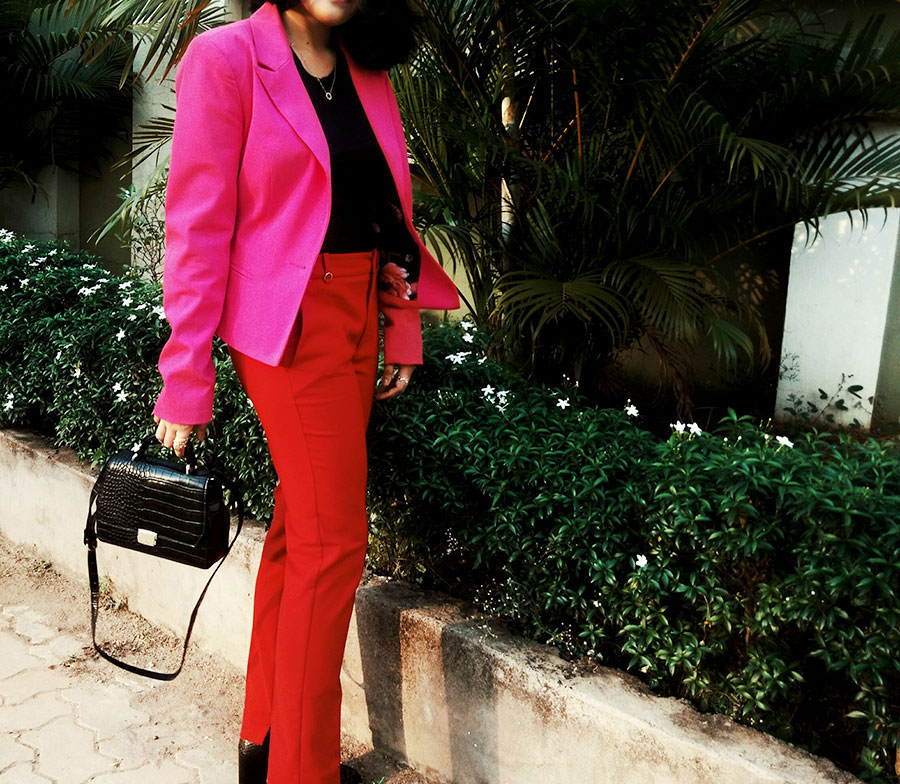 black basic tee,red trouser, pink blazer suit ,womens black boots, black bag