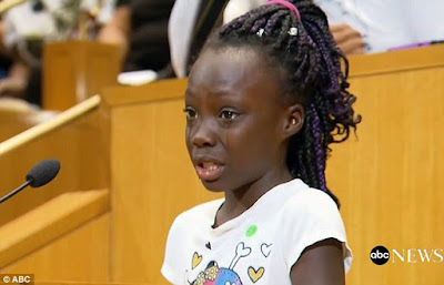 Zianna Oliphant (pictured) made a tearful plea to Charlotte city council to end the cop shootings of black people