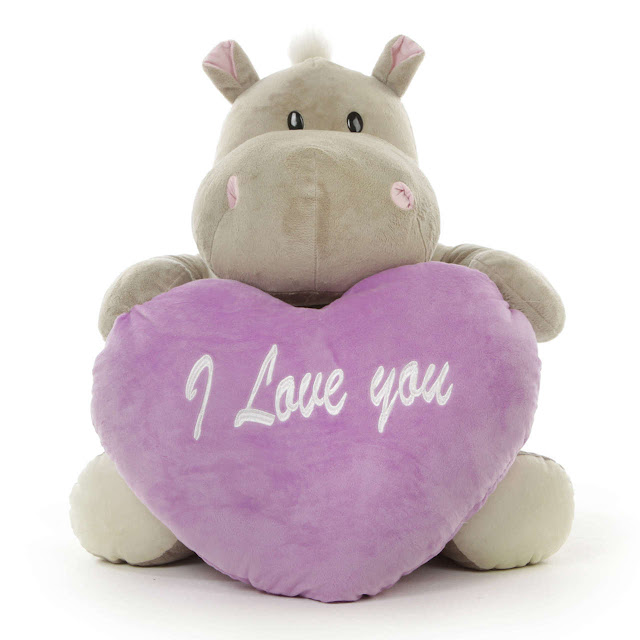 A sweet stuffed hippo holding a lavender