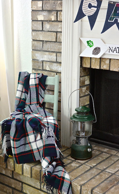 Coleman Lantern, Plaid throw.