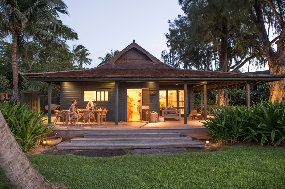 Gorgeous porch and backyard of beautiful oceanfront cottage on Maui - found on Hello Lovely Studio