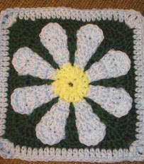 http://www.ravelry.com/patterns/library/daisy-flower-crochet-charity-square