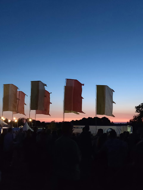 Flags at dusk at Cornbury Music Festival