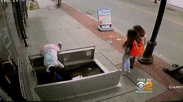 Terrifying moment woman on cellphone falls into open sidewalk cellar
