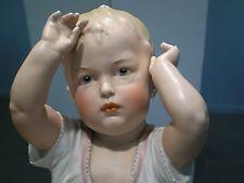 Detalle de la parte superior de una Baby Piano Doll Heubach