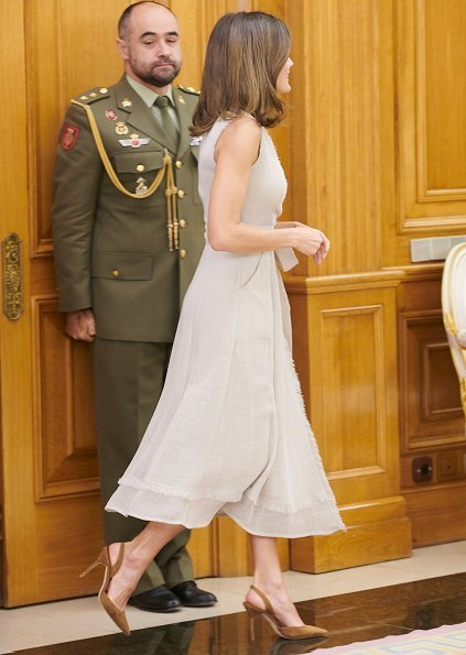 Queen Letizia wore Adolfo Dominguez wrap dress with frayed edges and she wore carolina herrera suede pumps