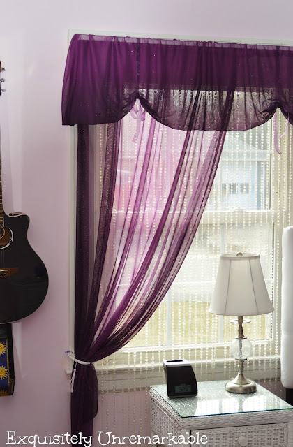 Purple Sheer Curtains on window with guitar on wall
