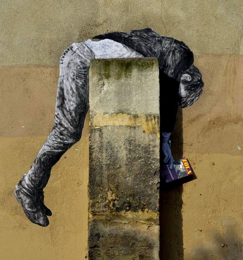 French artist Charles Leval known as 'Levalet'. The artist injects humor into the streets of Paris by gluing animals and human-shaped pasteups onto walls.