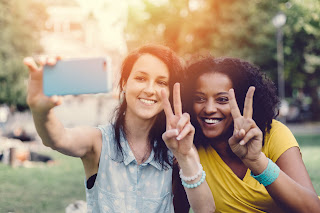 Photo of young women taking a selfie photo