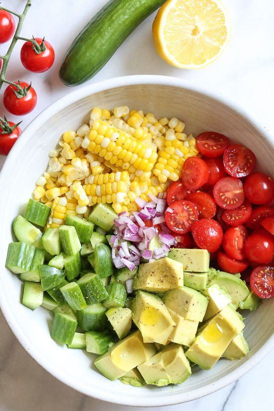 This Corn Tomato Avocado Salad is summer in a bowl! The perfect side dish with anything you're grilling, or double the portion as a main dish. Read more at https://www.skinnytaste.com/corn-tomato-avocado-salad/#HQZ3TSFwd1otXPgE.99